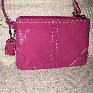 Pink patent Coach wristlet